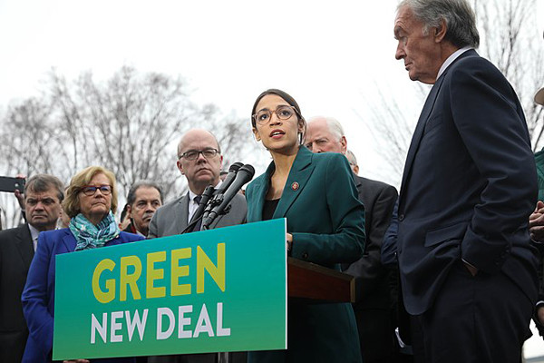 Alexandria Ocasio-Cortez speaks at a Green New Deal press event