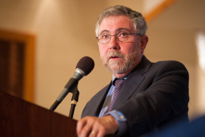 Paul Krugman speaking from a podium (growthism)