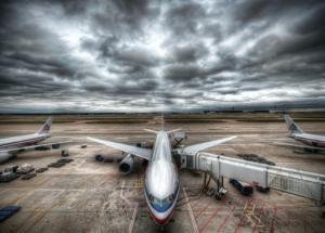Grounded airplane beneath a dark sky
