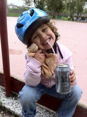 Kid drinking Coca Cola