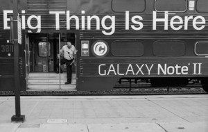 """Photo of a bus advertising the new Galaxy Note II phone, claiming that """"The Next Big Thing Is Here."""""""